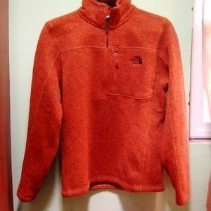 Orange North Face jacket